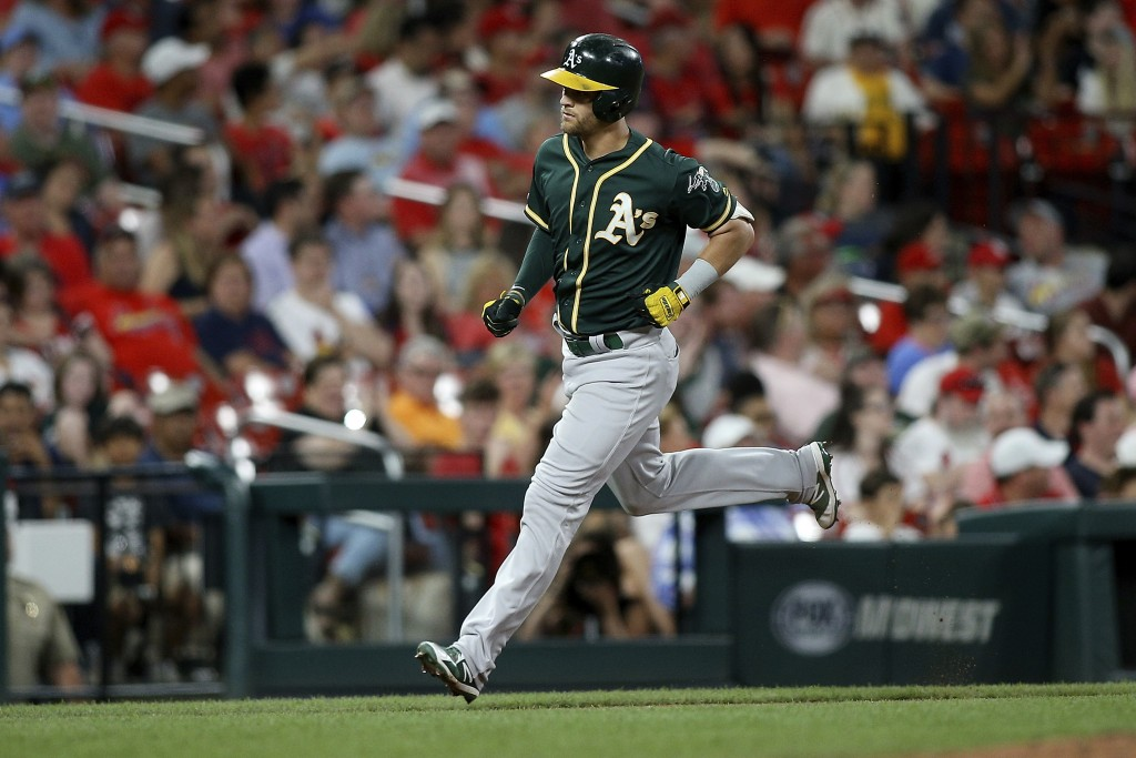 Oakland Athletics' Chad Pinder runs the bases after hitting a two-run home run during the fifth inning of the team's baseball game against the St. Lou...