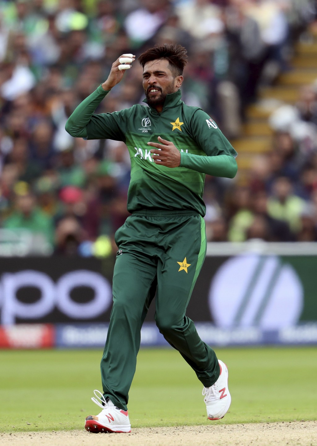 Pakistan's bowler Mohammad Amir reacts after his delivery during the Cricket World Cup match between New Zealand and Pakistan at the Edgbaston Stadium...