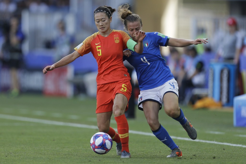 China's Wu Haiyan, left, vies for the ball with Italy's Aurora Galli during the Women's World Cup round of 16 soccer match between Italy and China at ...