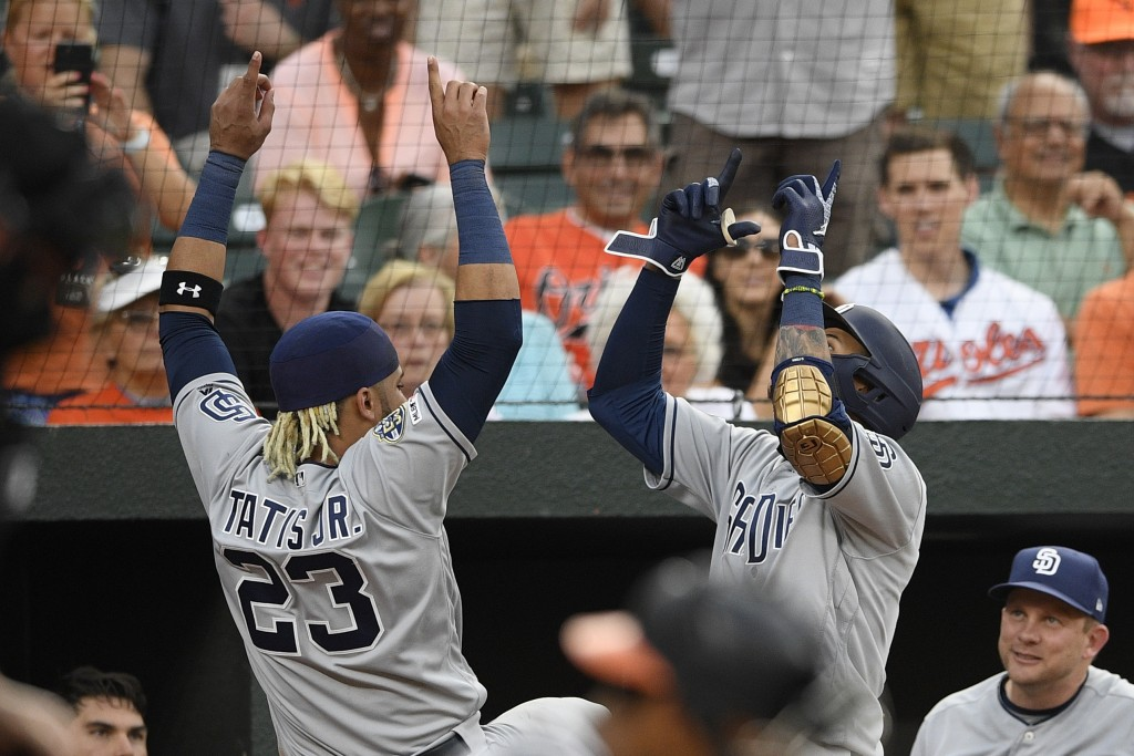 San Diego Padres' Manny Machado, right, celebrates his home run with Fernando Tatis Jr. (23) during the third inning of a baseball game against the Ba...