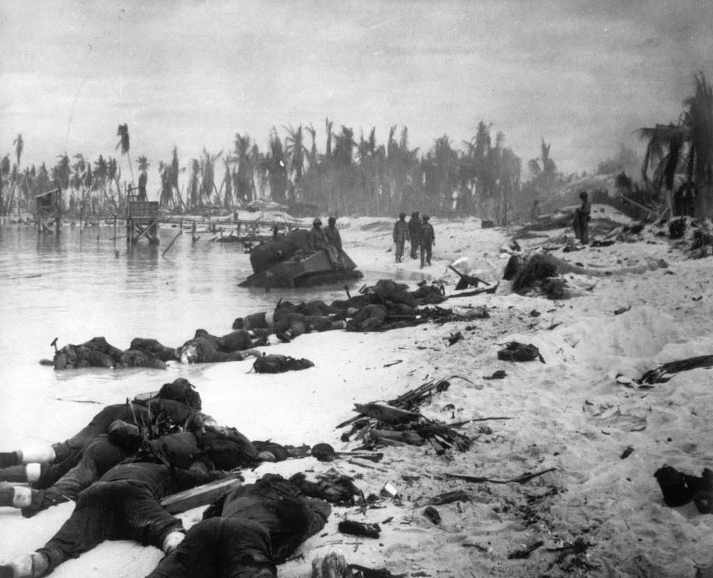 FILE - In this Nov. 1943 file photo, sprawled bodies are seen on the beach of Tarawa atoll testifying to the ferocity of the battle for this stretch o...