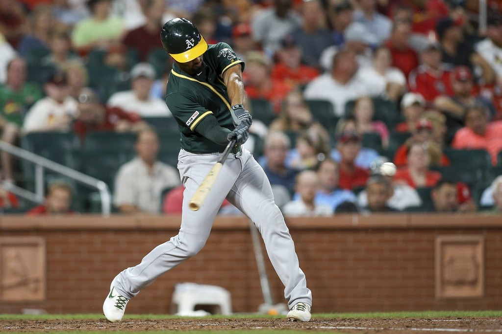 Oakland Athletics' Marcus Semien hits a solo home run during the fifth inning of the team's baseball game against the St. Louis Cardinals on Tuesday, ...