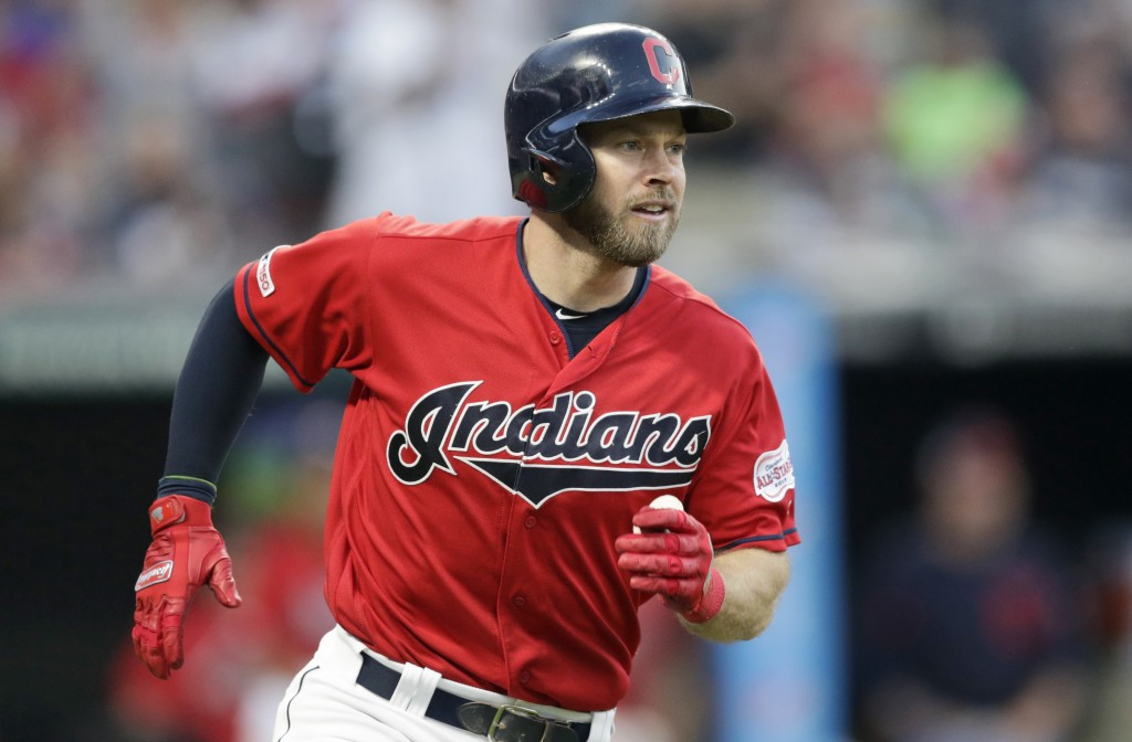 Cleveland Indians' Mike Freeman watches his ball after hitting a solo home run in the fifth inning in a baseball game against the Kansas City Royals, ...