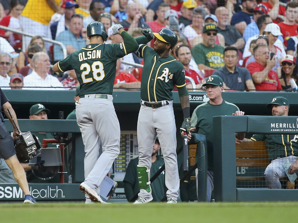 Oakland Athletics' Matt Olson, left, is congratulated by Jurickson Profar after hitting a solo home run during the second inning of the team's basebal...