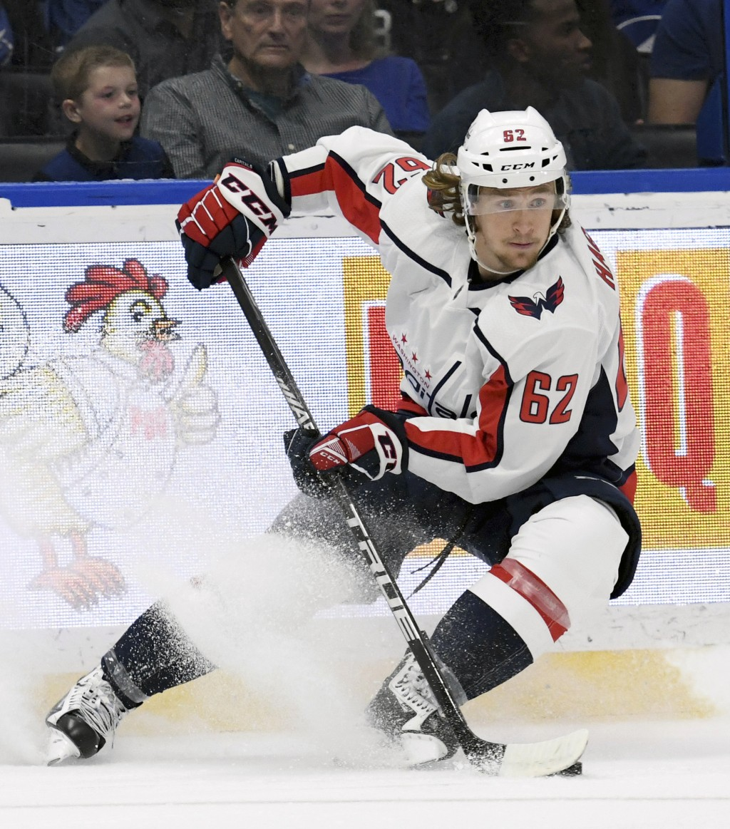FILE - In this March 16, 2019, file photo, Washington Capitals left wing Carl Hagelin skates with the puck during the third period of an NHL hockey ga