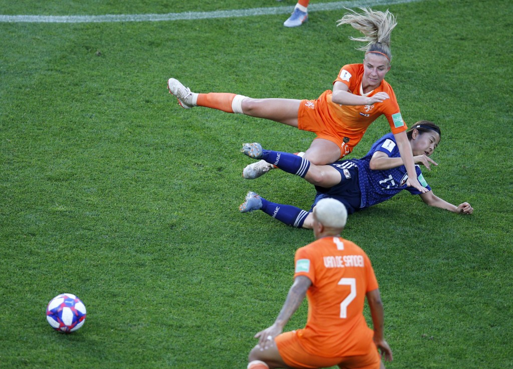 Netherlands' Jackie Groenen is tackled by Japan's Narumi Miura during the Women's World Cup round of 16 soccer match between the Netherlands and Japan...