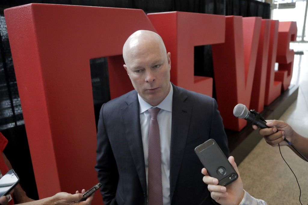 New Jersey Devils coach John Hynes, talks to reporters following a news conference introducing Jack Hughes, the No. 1 overall pick in the 2019 NHL hoc...