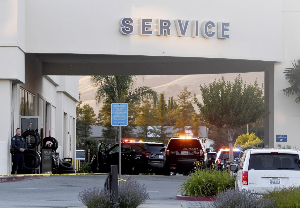Police investigate at the scene of a shooting at the Morgan Hill Ford Store in Morgan Hill, Calif., Tuesday, June 25, 2019. Police say at least three ...