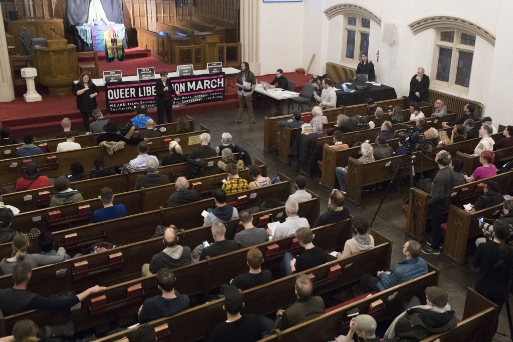 In this March 27, 2019, photo, activist Natalie James speaks during a meeting of the Reclaim Pride Coalition at the Church of the Village in New York....