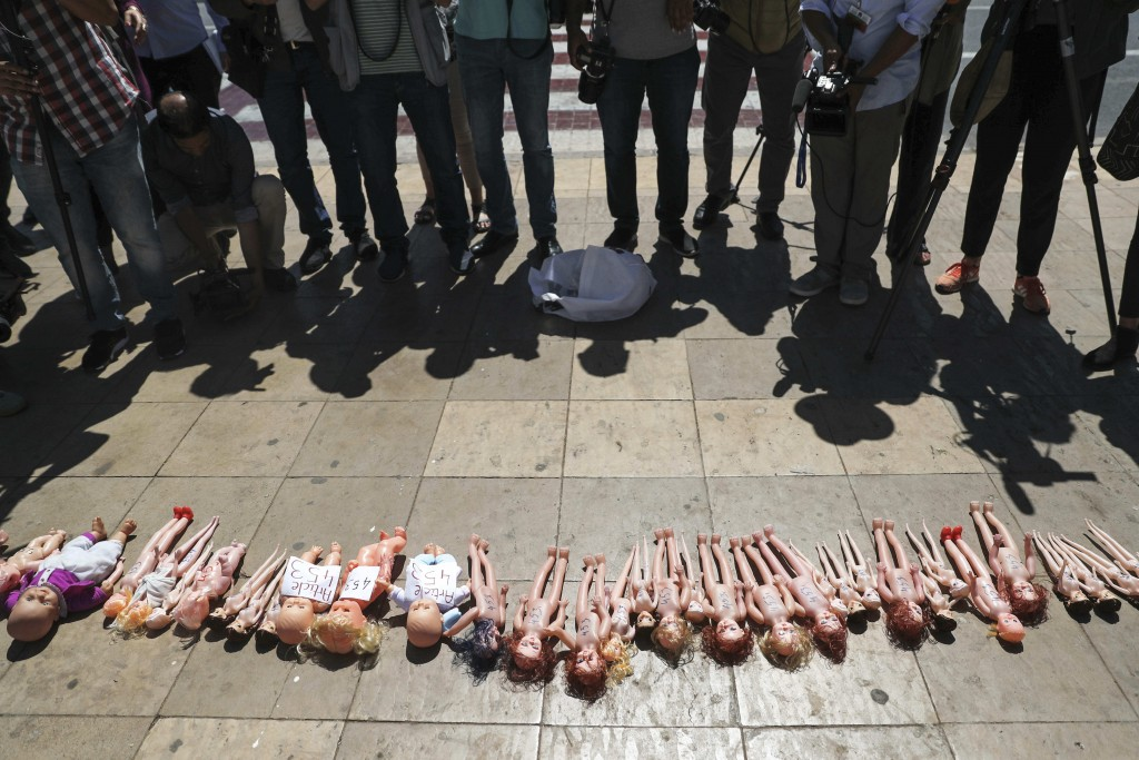 Dolls are laid out in front of Rabat's parliament by pro-choice protesters, to pressure legislatures to pass a law to protect women from unsafe and cl...