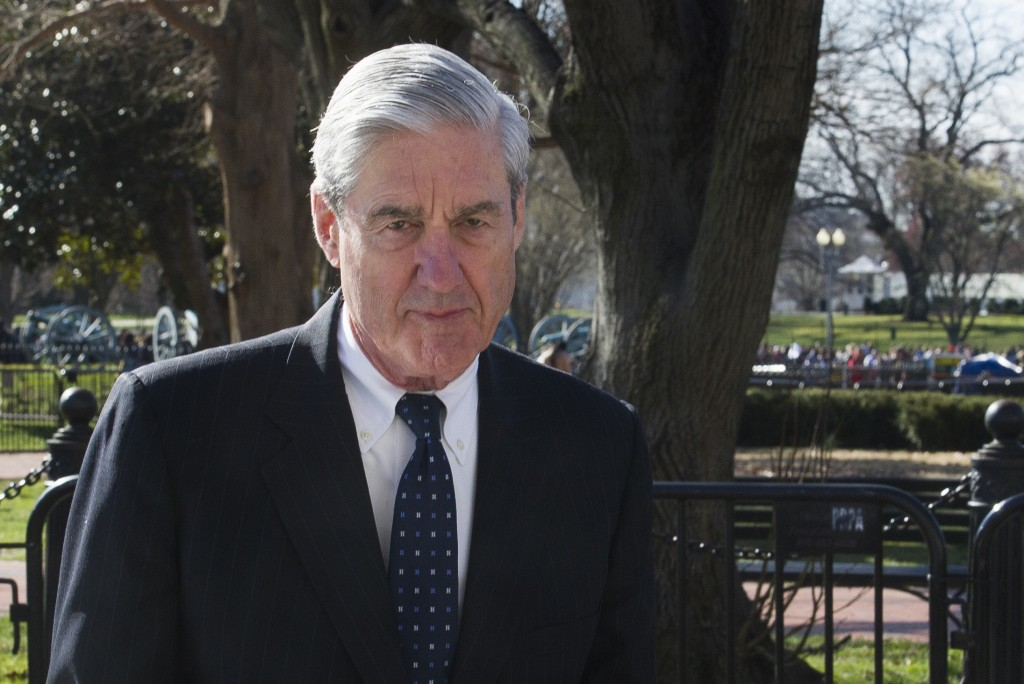 FILE - In this March 24, 2019 photo, then-special counsel Robert Mueller walks past the White House, after attending St. John's Episcopal Church for m...