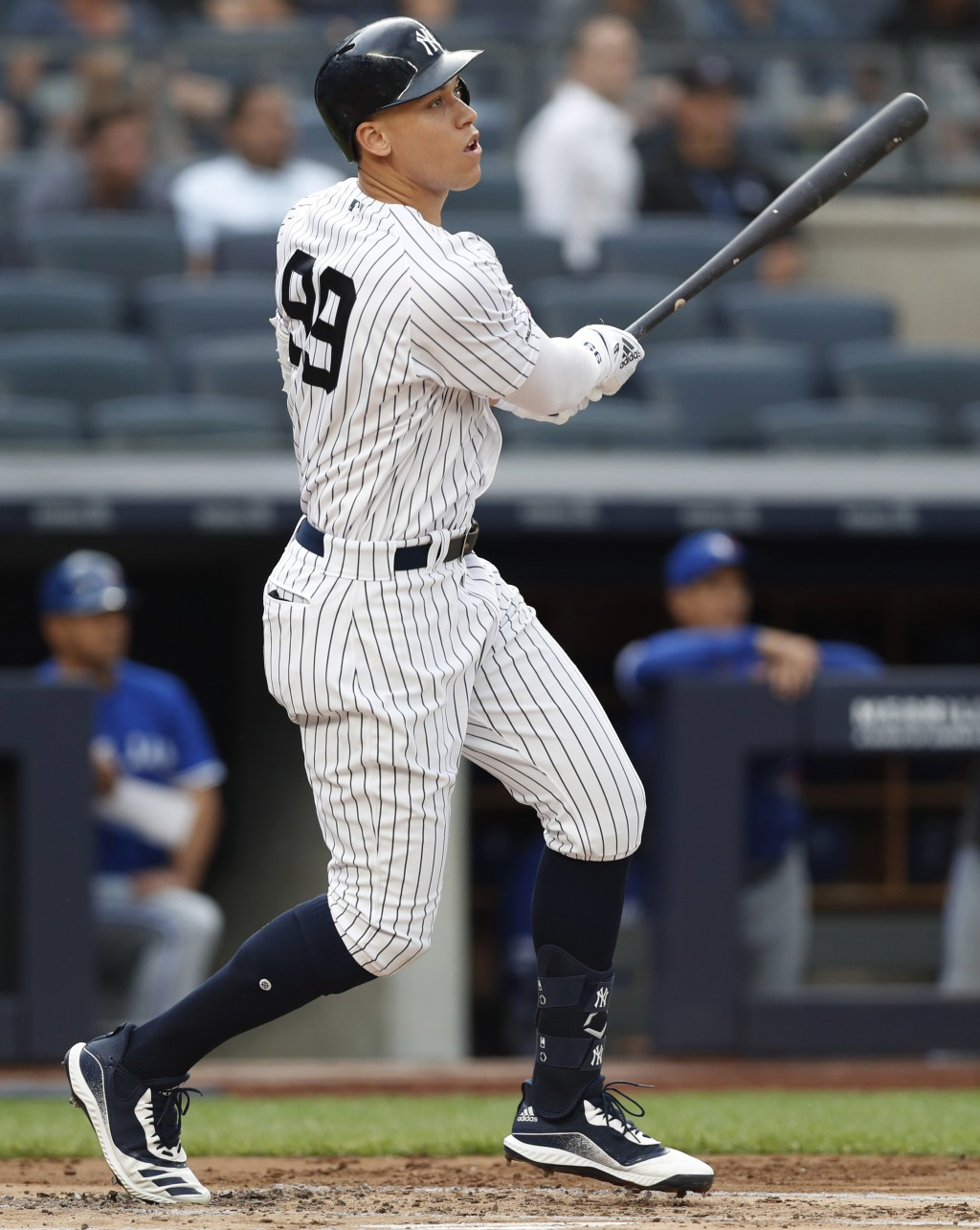 New York Yankees' Aaron Judge watches his solo home run during the first inning of the team's baseball game against the Toronto Blue Jays, Tuesday, Ju