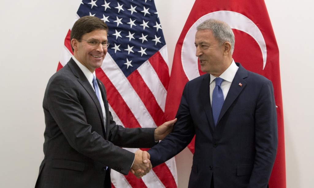 Acting U.S. Secretary for Defense Mark Esper, left, greets Turkish Defense Minister Hulusi Akar prior to a meeting of NATO defense ministers at NATO h...