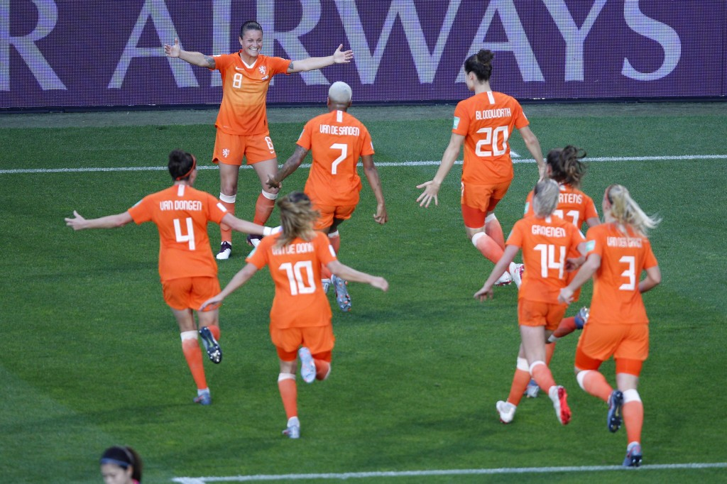 Netherlands' players celebrate their first goal during the Women's World Cup round of 16 soccer match between the Netherlands and Japan at Roazhon Par...