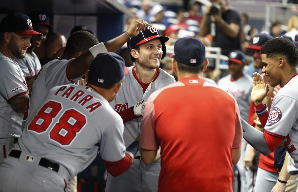 Washington Nationals' Trea Turner, center, is congratulated by teammates after Turner hit a three-run home run during the fourth inning of the team's ...