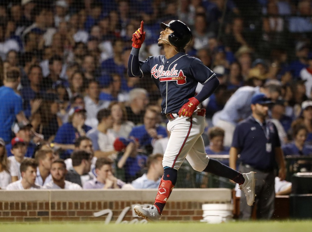 Atlanta Braves' Ozzie Albies celebrates his two-run home run off Chicago Cubs relief pitcher Mike Montgomery during the seventh inning of a baseball g...