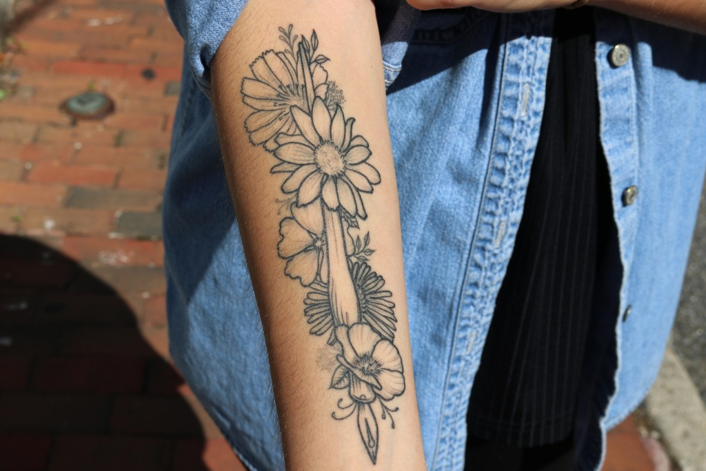 In this June 14, 2019, photo, Selene San Felice, a journalist with the Capital Gazette, shows a tattoo in Annapolis, Md., she recently had made on her...
