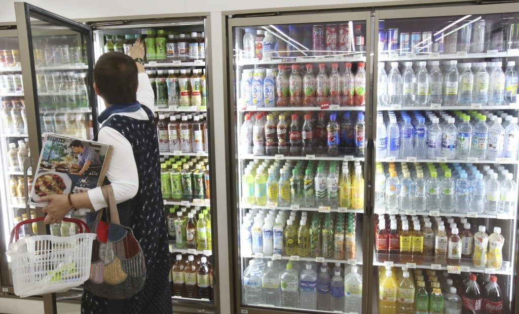 In this June 17, 2019, photo, plastic-bottled soft drinks are displayed in fridges at a Seven-Eleven store in Yokohama, near Tokyo. Japan has a plasti...