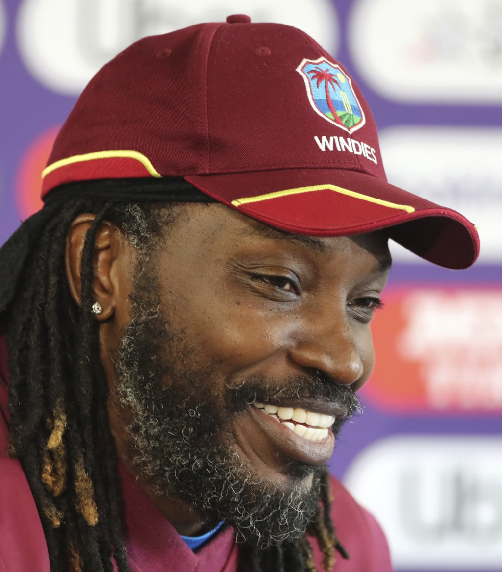 West Indies' Chris Gayle smiles during a press conference after attending a training session ahead of their Cricket World Cup match against India at O...