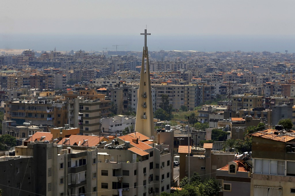 This Monday, June 24, 2019 photo, shows a church in the village of Hadat, where only Christians can rent or buy property, near Beirut, Lebanon. The to