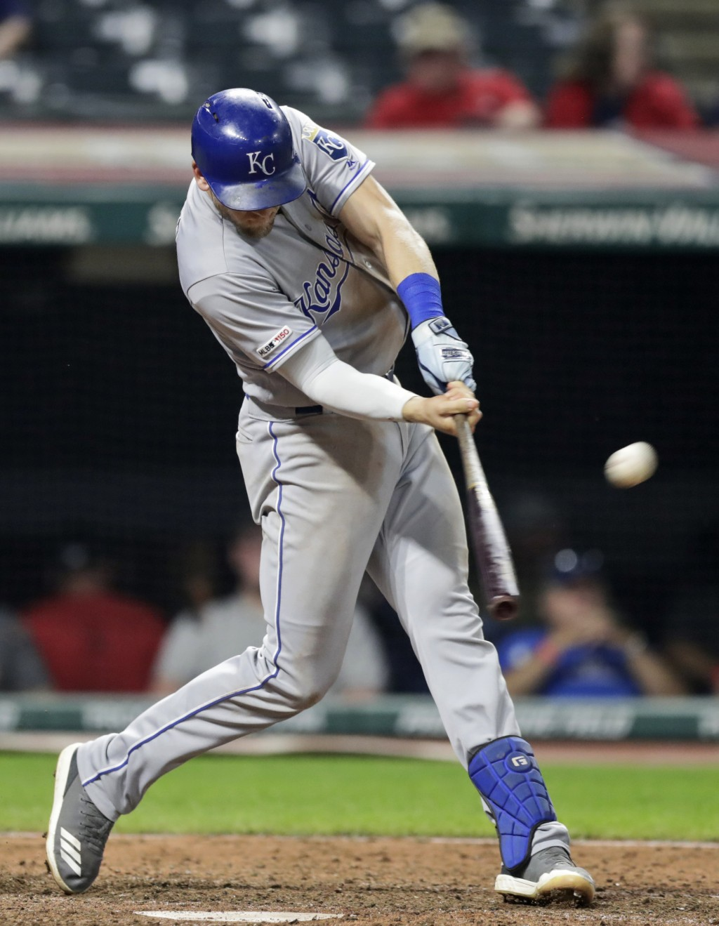 Kansas City Royals' Hunter Dozier hits a grand slam in the ninth inning of a baseball game against the Cleveland Indians, Tuesday, June 25, 2019, in C...