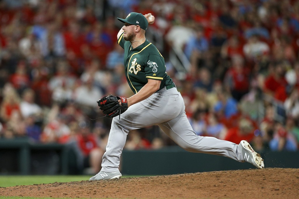 Oakland Athletics relief pitcher J.B. Wendelken throws during the fourth inning of the team's baseball game against the St. Louis Cardinals on Tuesday...