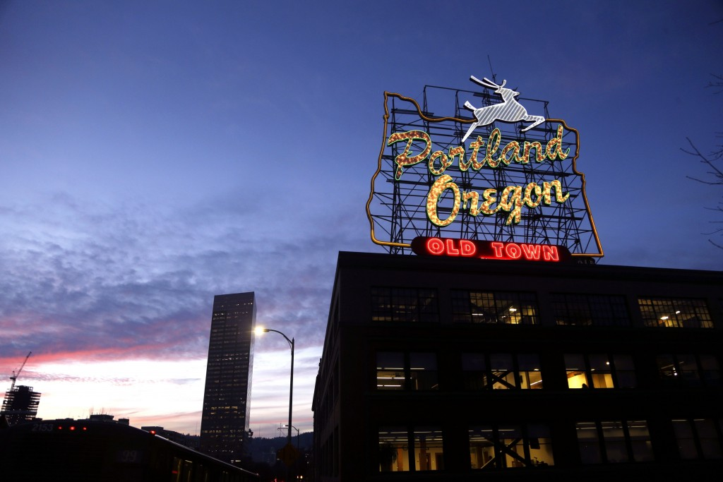 """FILE - This Jan. 27, 2015, file photo, shows the """"Portland, Oregon"""" sign in downtown Portland, Ore. The stark divide in Oregon between the state's lib..."""