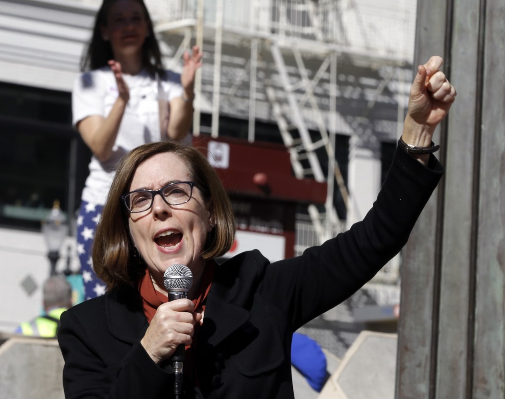 FILE  - In this Oct. 17, 2018, file photo, Oregon Gov. Kate Brown speaks during a rally in Portland, Ore. The stark divide in Oregon between the state...