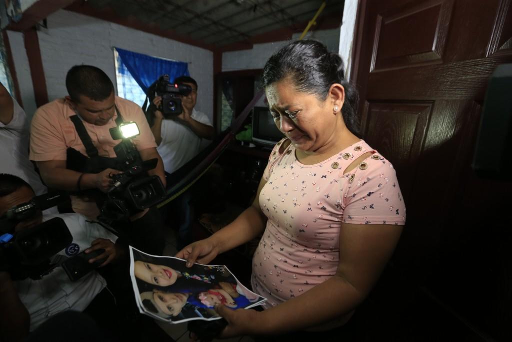 Rosa Ramirez cries when shown a photograph printed from social media of her son Oscar Alberto Martinez Ramírez, 25, granddaughter Valeria, nearly 2, a...