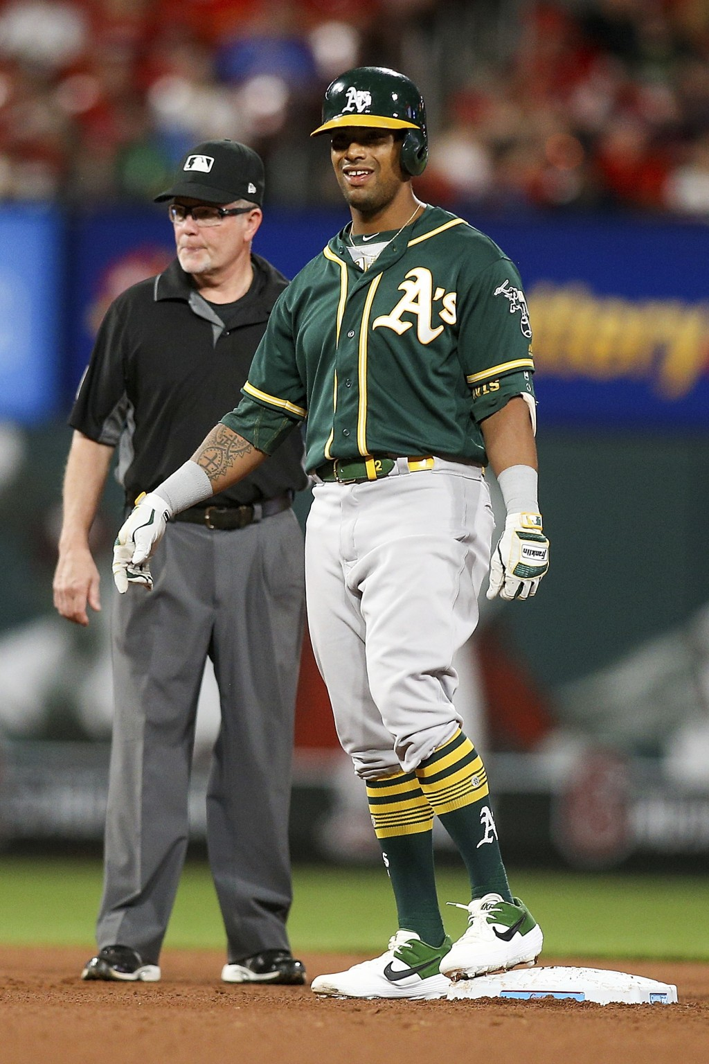 Oakland Athletics' Khris Davis smiles while standing on second base after hitting a two-run double during the fifth inning of the team's baseball game...