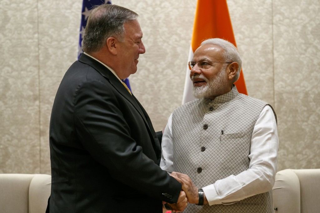 Secretary of State Mike Pompeo, left, shakes hands with Indian Prime Minister Narendra Modi, during their meeting at the Prime Minister's Residence, W...