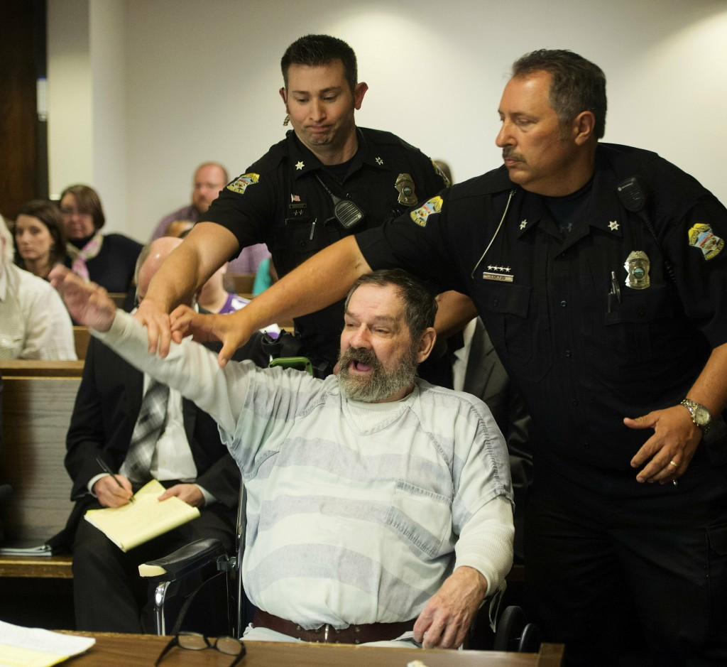 FILE - In this Nov. 10, 2015, file photo, Frazier Glenn Miller Jr., convicted of capital murder, attempted murder and other charges, gestures as Johns...