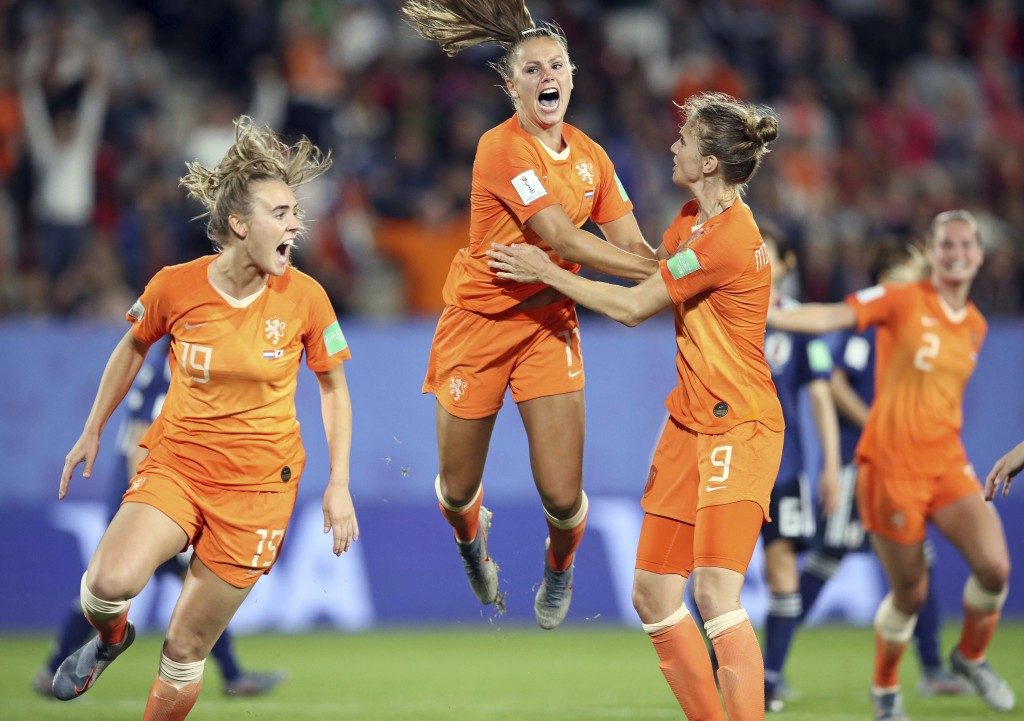 Netherlands' Lieke Martens, center, celebrates after scoring her side's second goal from the penalty spot during the Women's World Cup round of 16 soc...