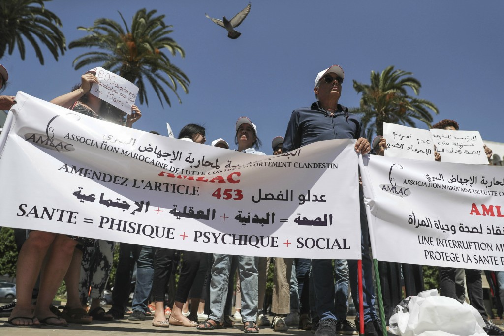 Pro-choice protesters gather in front of Rabat's parliament to pressure legislatures to pass a law to protect women from unsafe and clandestine aborti...