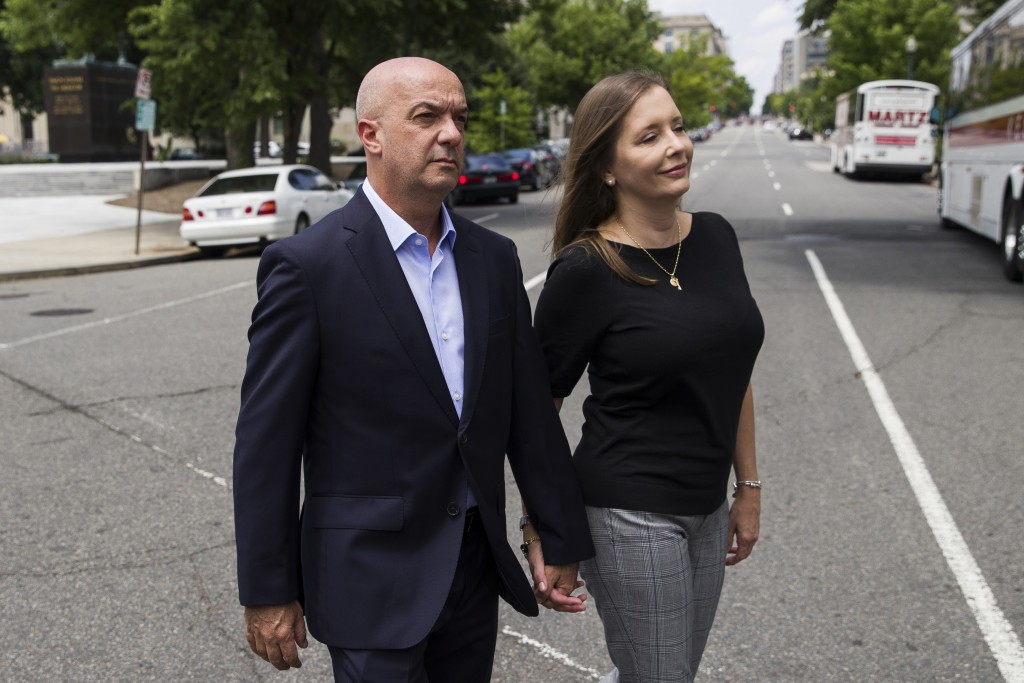 In this June 24, 2019, photo, Former Venezuelan police commissioner Ivan Simonovis walks across the street as he poses for a photograph with his wife ...