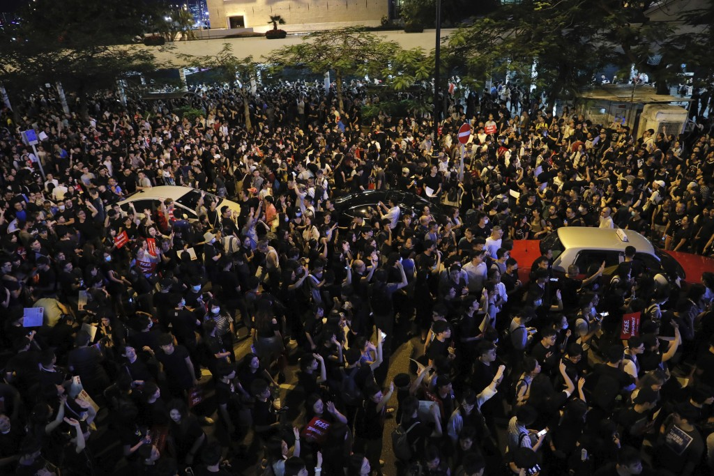 In this Wednesday, June 26, 2019, file photo, protesters take part in a rally in Hong Kong. Thousands of people joined Hong Kong's latest protest rall...