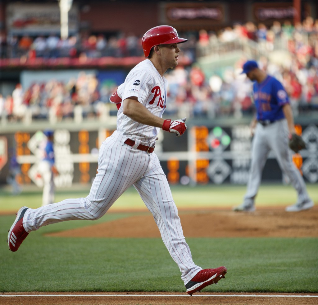 Philadelphia Phillies' Scott Kingery, left, rounds the bases after hitting a home run off New York Mets starting pitcher Walker Lockett, right, during...