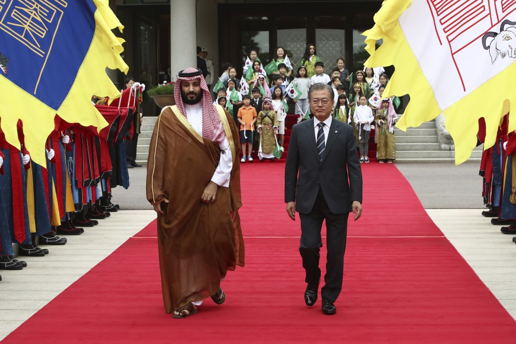 South Korean President Moon Jae-in, right, and Saudi Crown Prince Mohammed bin Salman view an honor guard during a welcoming ceremony at the president...