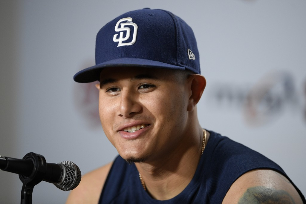 San Diego Padres' Manny Machado talks to the media before a baseball game against the Baltimore Orioles, Tuesday, June 25, 2019, in Baltimore. (AP Pho...