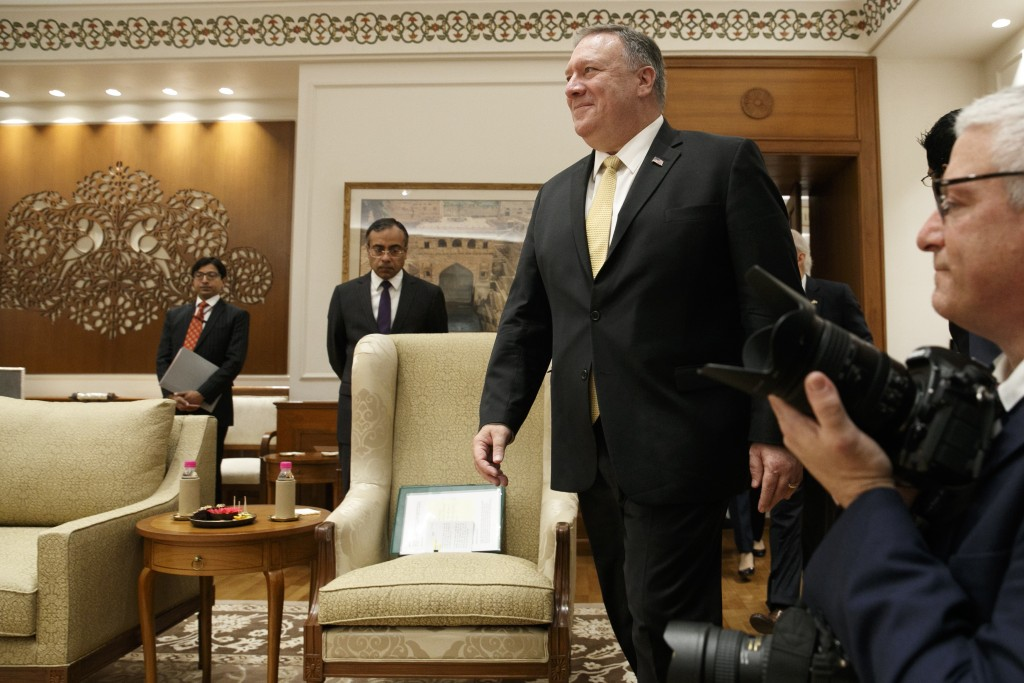 U.S. Secretary of State Mike Pompeo enters the room to meet with Indian Prime Minister Narendra Modi, at the Prime Minister's Residence, Wednesday, Ju...