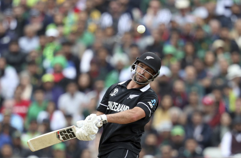 New Zealand's batsman Colin de Grandhomme avoids a bouncer during the Cricket World Cup match between New Zealand and Pakistan at the Edgbaston Stadiu...
