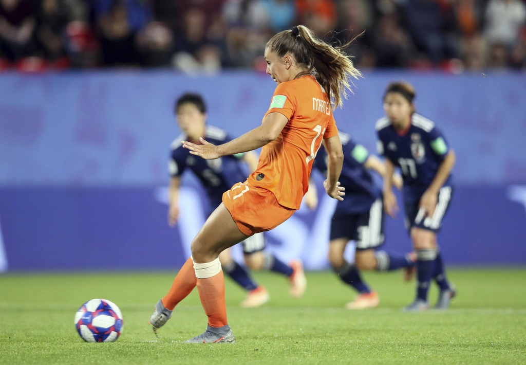 Netherlands' Lieke Martens scores her side's second goal from the penalty spot during the Women's World Cup round of 16 soccer match between the Nethe...