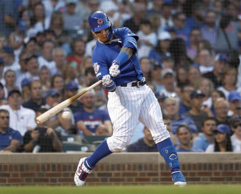 Chicago Cubs' Willson Contreras hits a two-run double off Atlanta Braves starting pitcher Max Fried during the fourth inning of a baseball game, Tuesd...