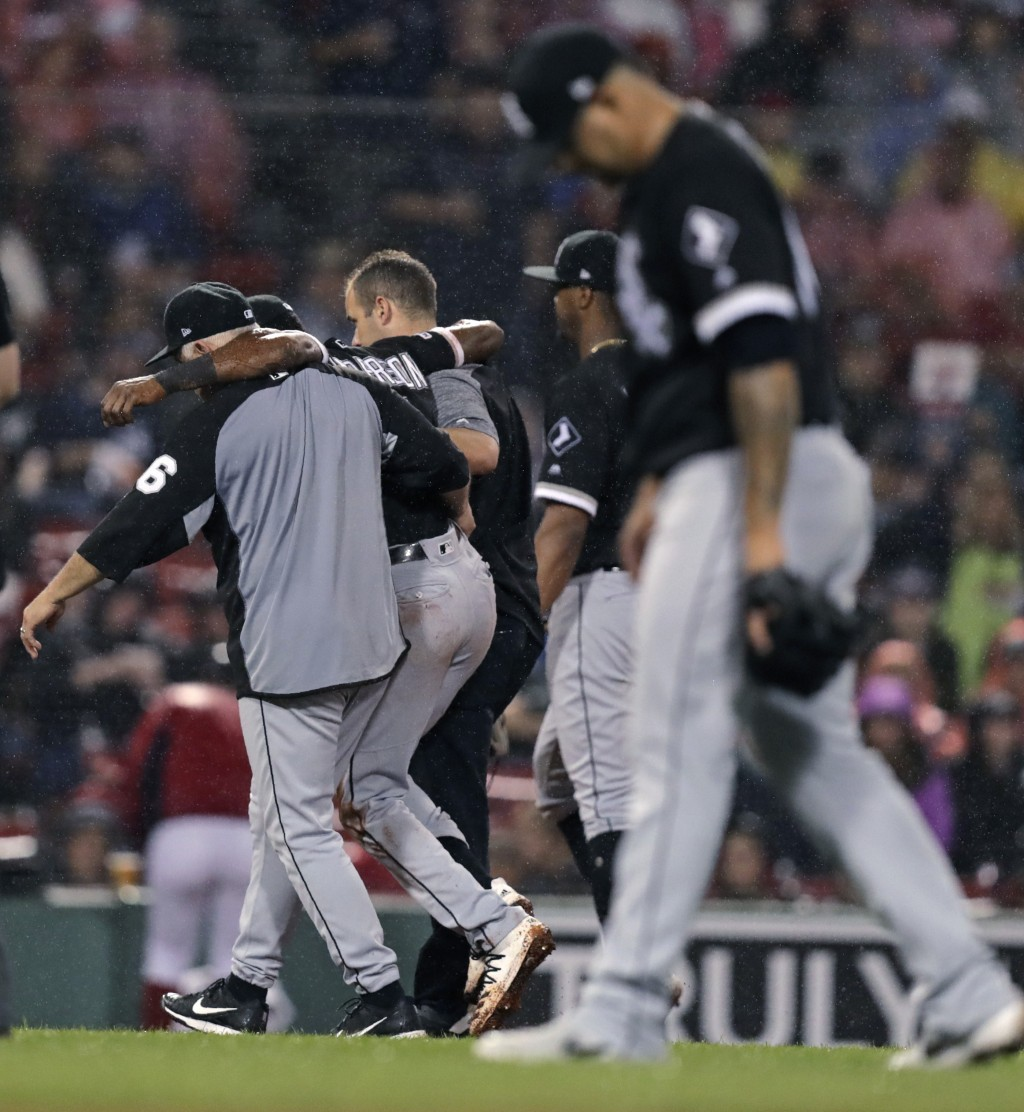 Chicago White Sox's Tim Anderson is helped from the field after an injury during the fifth inning of a baseball game against the Boston Red Sox at Fen...