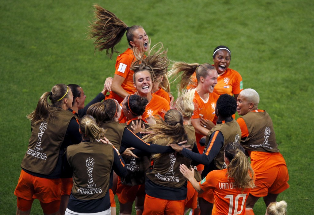Netherlands' Lieke Martens, top, celebrates with teammates after scoring her team's second goal from the penalty spot during the Women's World Cup rou...