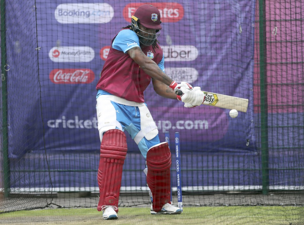 West Indies' Chris Gayle bats in the nets during a training session ahead of their Cricket World Cup match against India at Old Trafford in Manchester...