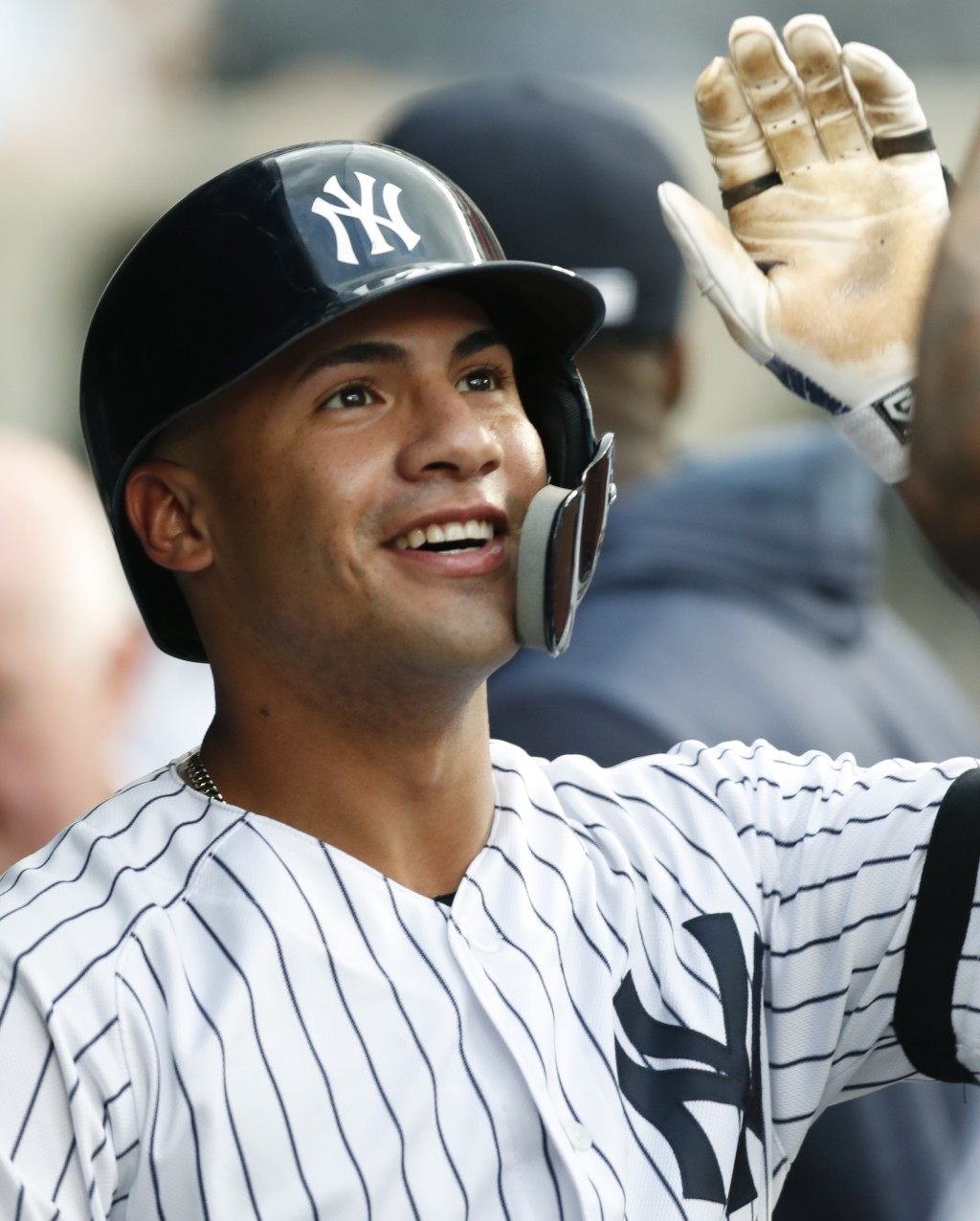 New York Yankees' Gleyber Torres reacts in the dugout after hitting a solo home run against the Toronto Blue Jays during the second inning of a baseba...