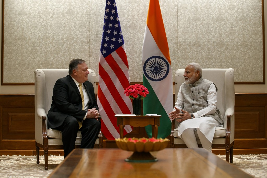 Secretary of State Mike Pompeo, left, talks with Indian Prime Minister Narendra Modi, during their meeting at the Prime Minister's Residence, Wednesda...