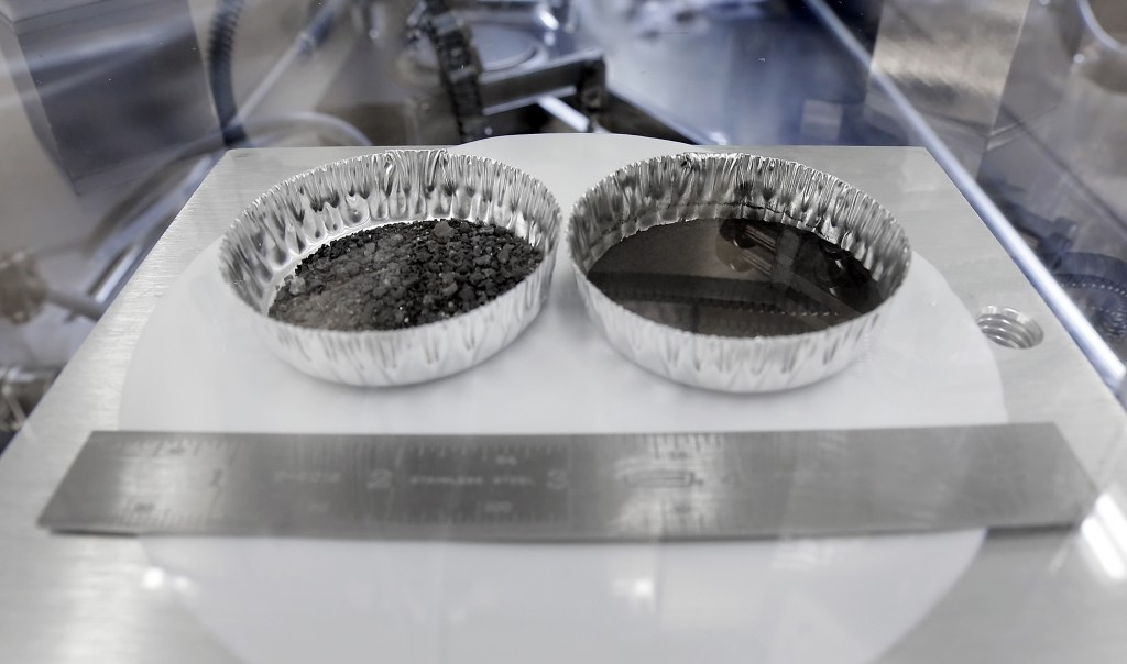 Two separate 2 inch foil pans hold lunar dirt, from the last shovel full collected by Neil Armstrong on the Apollo 11, in the lunar lab at the NASA Jo...