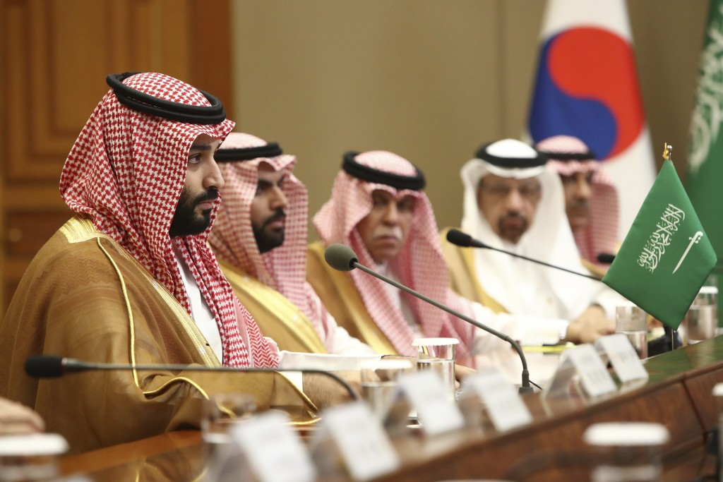 Saudi Crown Prince Mohammed bin Salman, left, speaks with South Korean President Moon Jae-in, not pictured, at the presidential Blue House, Wednesday,...